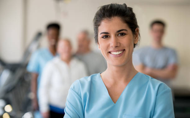 Beautiful physical therapist at the clinic looking at camera smiling stock photo