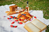 istock Beautiful picnic with rose wine, French croissants and fresh berries 1150744715