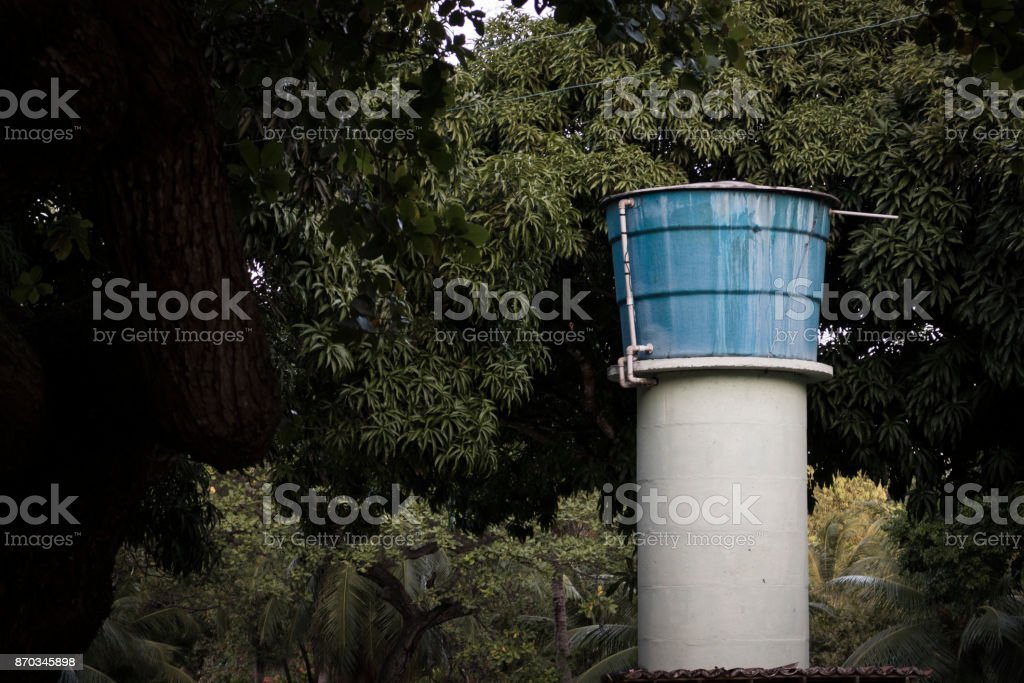 Beautiful picture of cistern among nature. Water reservoir. Archtecture and forest. stock photo