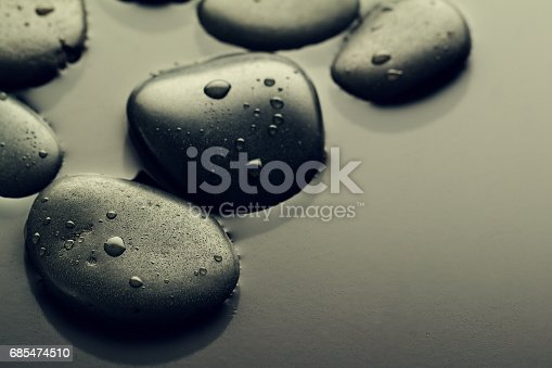 istock Beautiful picture of Spa Hot Stones, View from Above. Dark Background. Top. Spa Concept. Side Composition. 685474510