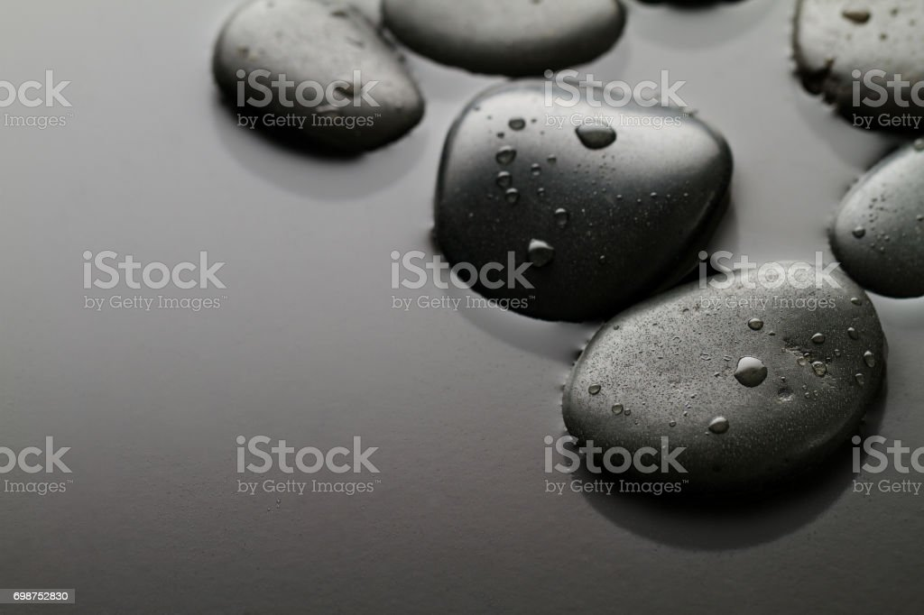 Beautiful picture of Spa Hot Stones, View from Above. Dark Background. Top. Spa Concept. Side Composition. stock photo
