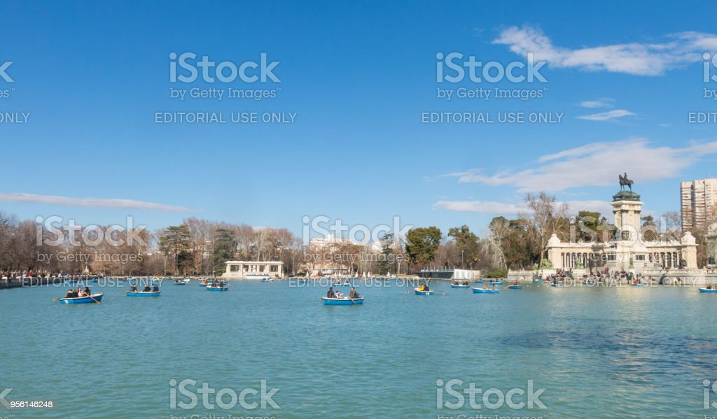 Beautiful picture of tourists on boats at Monument to Alfonso XII in the Parque del Buen Retiro. in Madrid, Spain stock photo