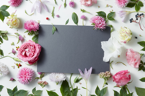 istock Beautiful pink and white flowers with empty notebook 614026088