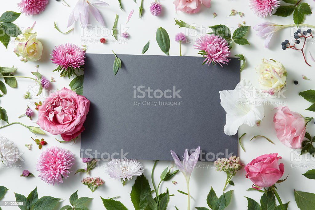 Beautiful pink and white flowers with empty notebook stock photo