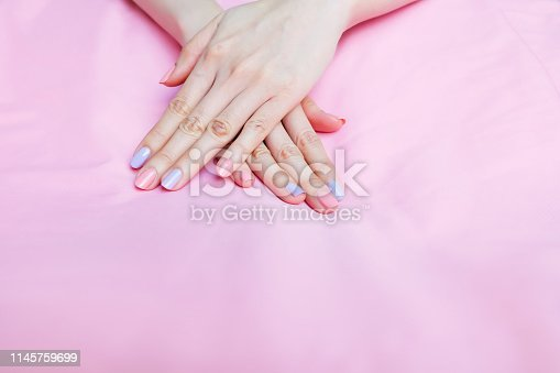 istock Beautiful Pink Nail Polish. Female Hands with Pink Nails Manicure on Pink Fabric Background Great for Any Use. 1145759699