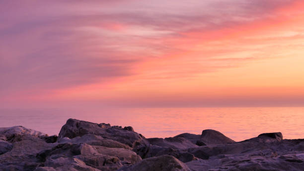 Beautiful pink, orange, purple and red sunset over the sea. stock photo