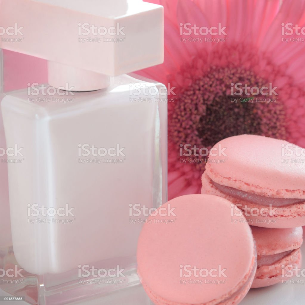 Beautiful Pink Perfume Bottles With Flower And Macaroons Luxury