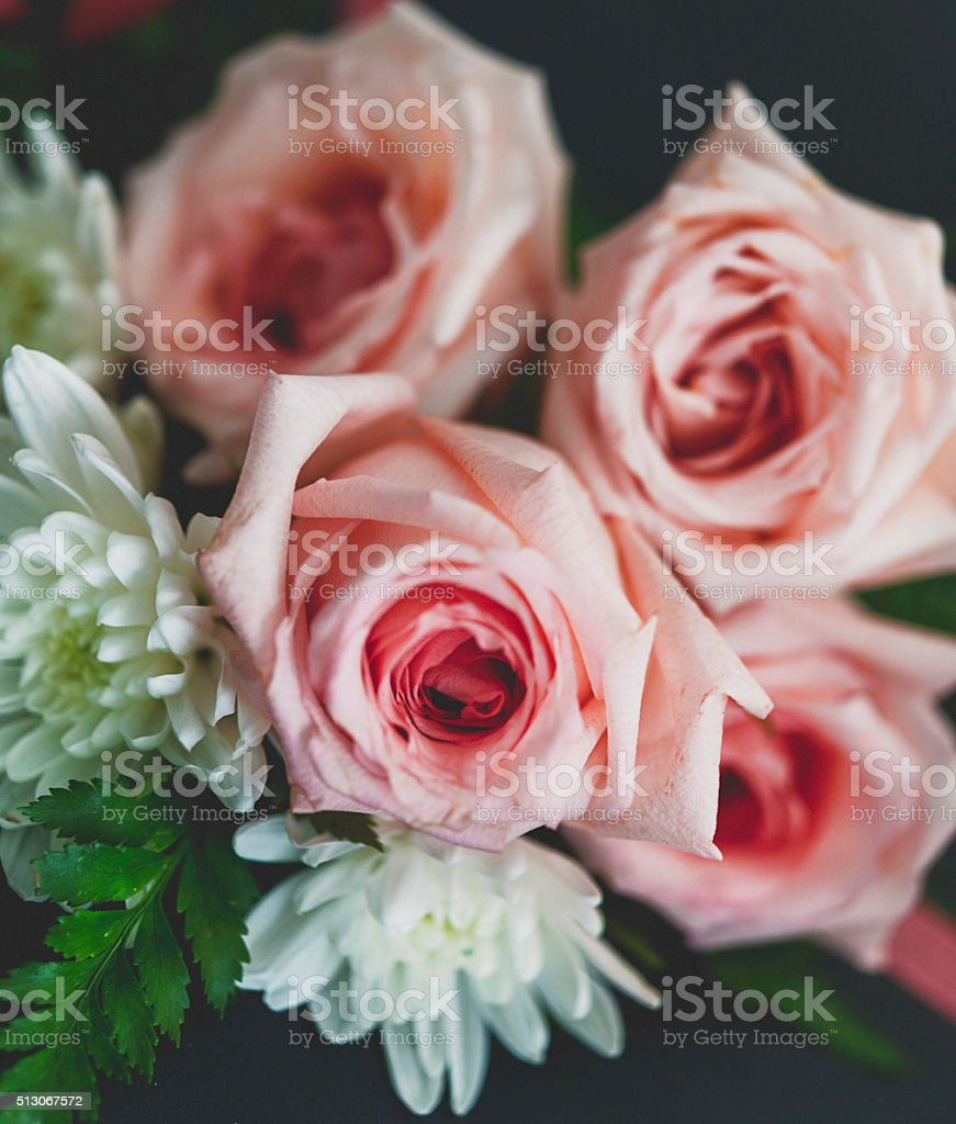 Beautiful pink roses and white dahlia on black background stock beautiful pink roses and white dahlia on black background royalty free stock photo izmirmasajfo