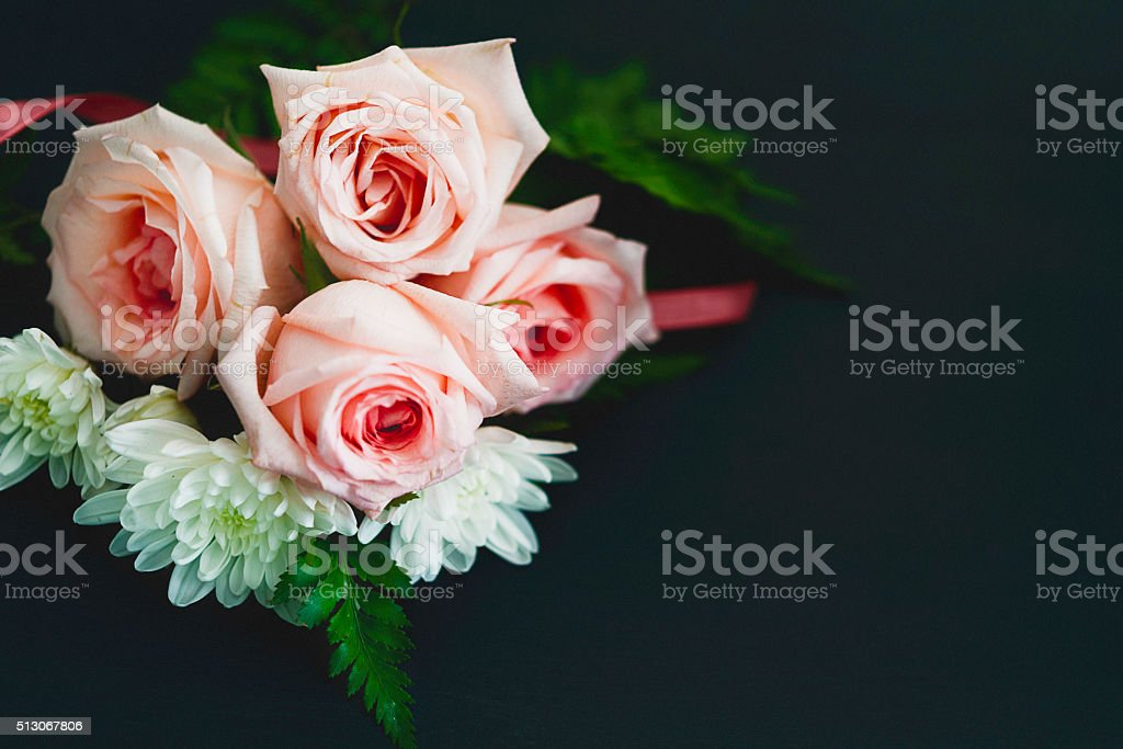 Beautiful pink roses and white dahlia on black background stock photo