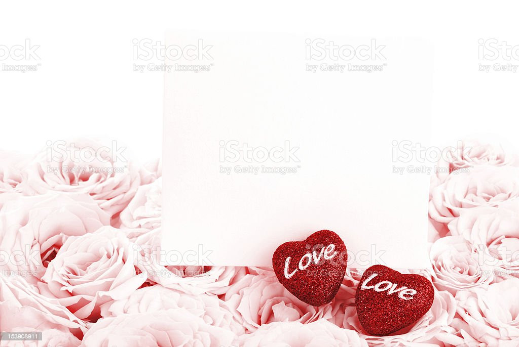 Beautiful pink roses with gift card & hearts royalty-free stock photo