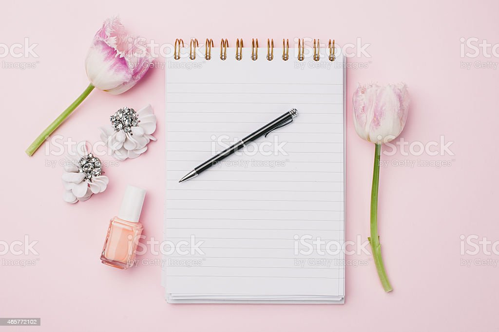 Beautiful pink setting with notebook and flowers stock photo
