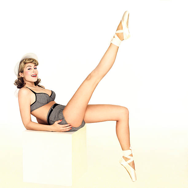 beautiful pin-up girl in a bathing suit - pin up girl stock pictures, royalty-free photos & images
