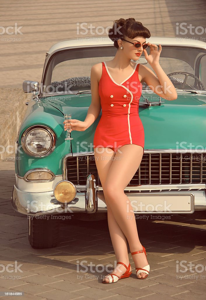 Beautiful Pin-Up Girl  In Front Of  The Vintage Car stock photo