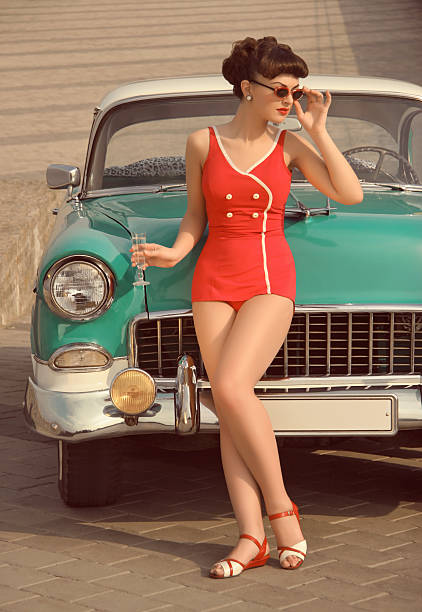 beautiful pin-up girl  in front of  the vintage car - pin up girl stock pictures, royalty-free photos & images