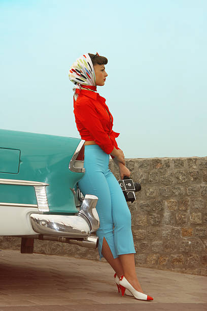 Beautiful Pin-Up Girl  Near The Vintage Car stock photo