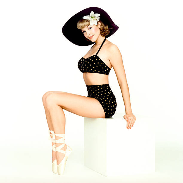 beautiful pin-up girl wearing a black bathing suit - pin up girl stock pictures, royalty-free photos & images