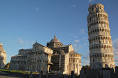 Beautiful Pisa tower and Pisa cathedral in the blue sky