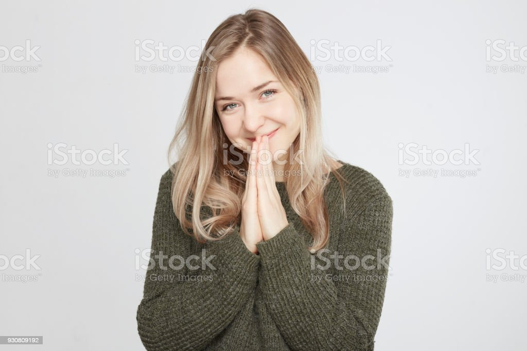 Beautiful pleased young female has broad smile stock photo