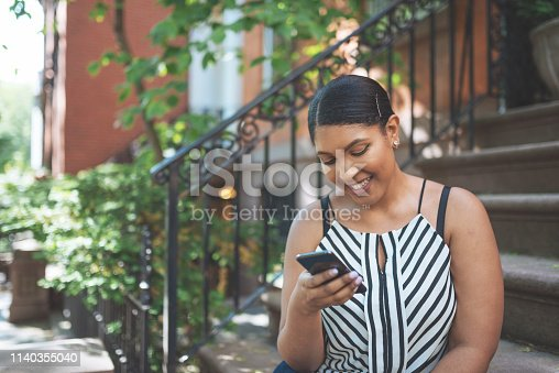 Portrait of plus size Dominican - Latina millennial woman in New York, USA