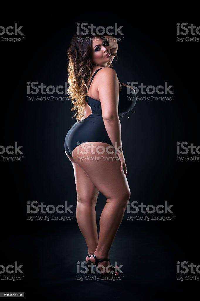 Beautiful plus size model in swimsuit, xxl woman stock photo