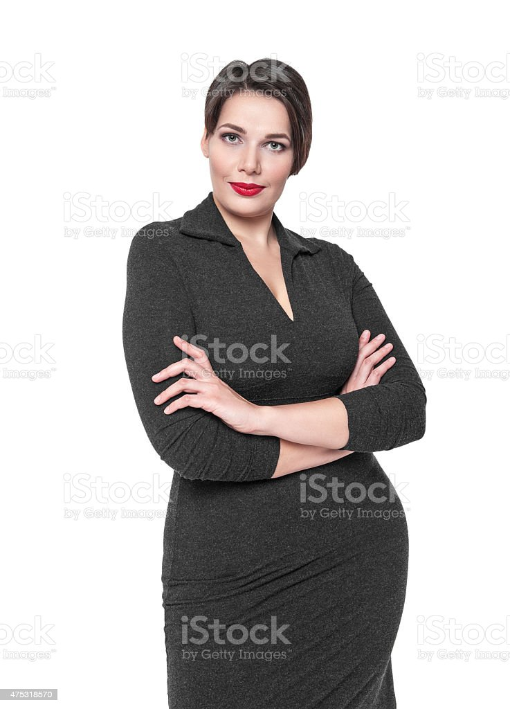 Beautiful plus size woman in black dress posing stock photo