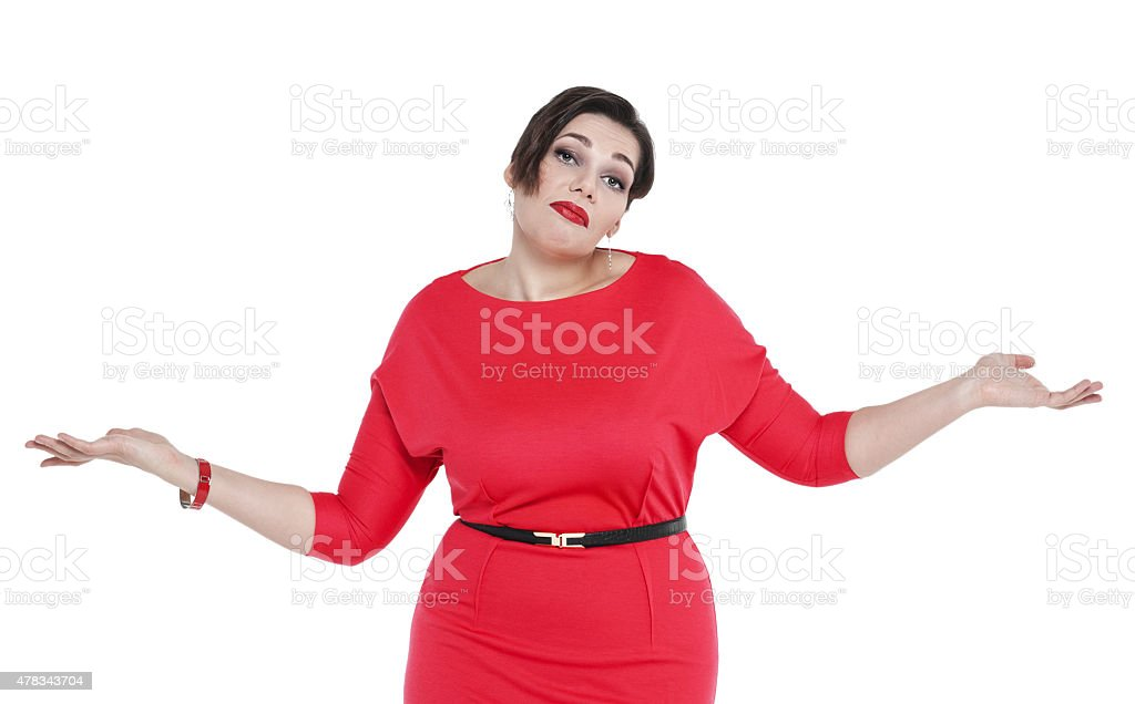 beautiful plus size woman in red dress shrugs her shoulders stock