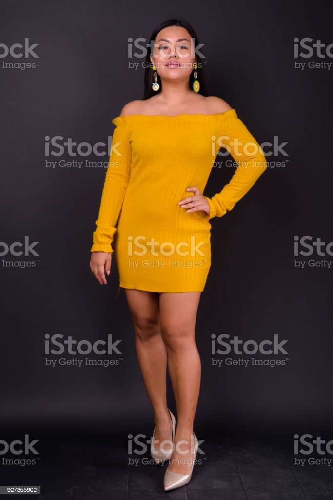 Beautiful Plus Size Woman Model Against Black Background - Royalty-free 25-29 Years Stock Photo