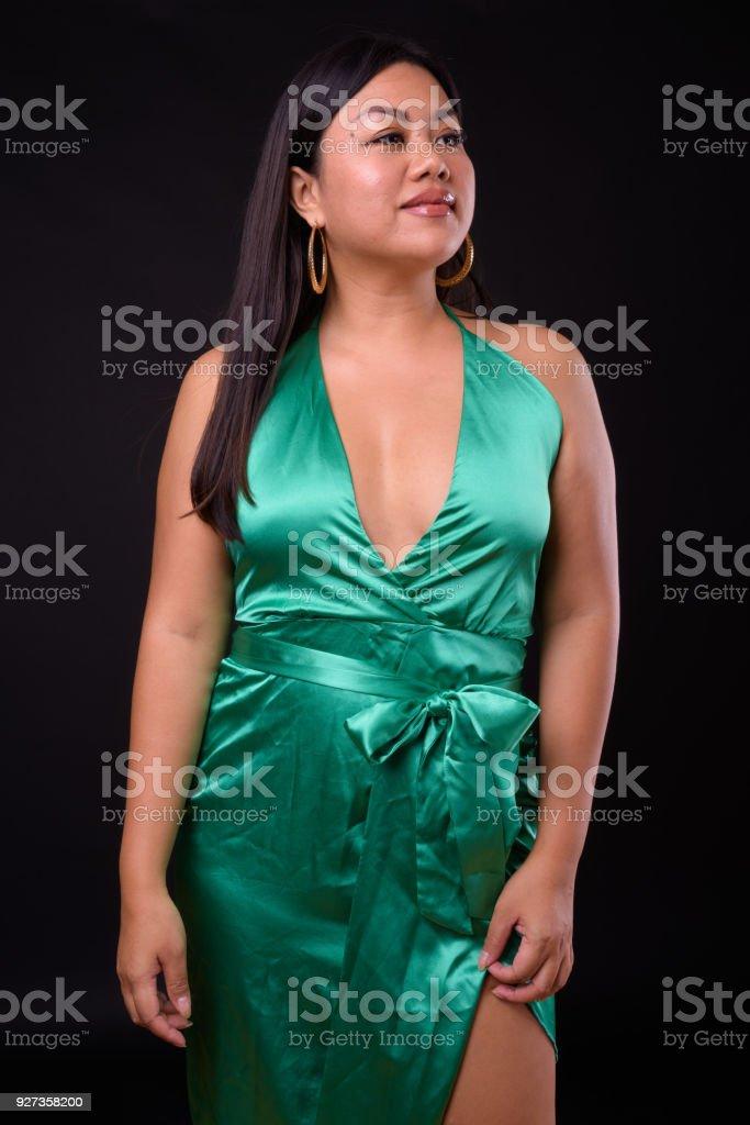 Beautiful Plus Size Woman Model Against Black Background Studio Portrait Of Beautiful Woman Plus Size Asian Model From Thailand Against Black Background 25-29 Years Stock Photo