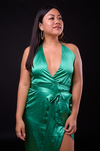 Beautiful Plus Size Woman Model Against Black Background Stock Photo - Download Image Now