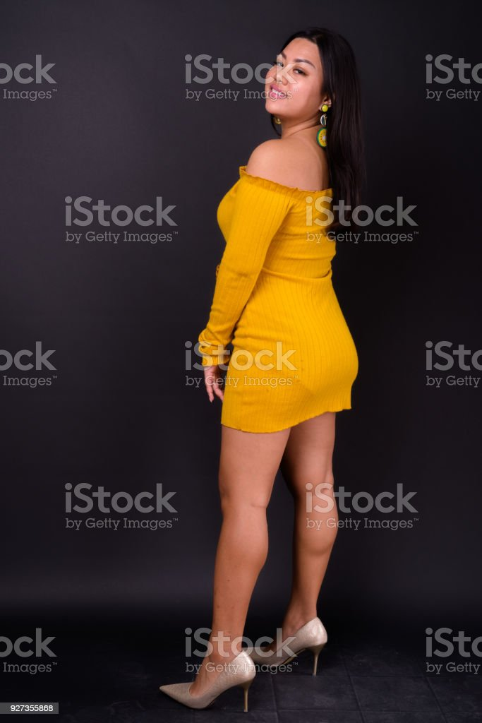 Beautiful Plus Size Woman Model Smiling Against Black Background - Royalty-free 25-29 Years Stock Photo
