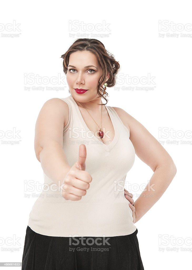 Beautiful plus size woman showing thumbs up sign stock photo