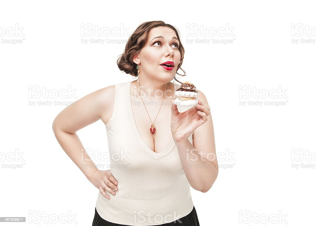 Beautiful plus size woman temptating with pastry stock photo