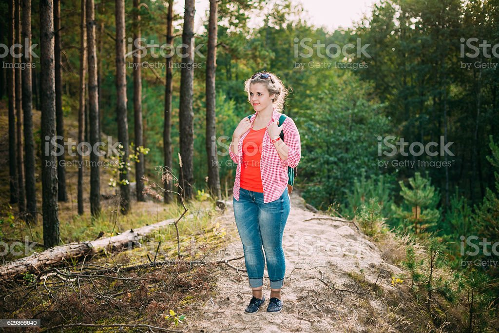 Beautiful Plus Size Young Woman In Shirt Posing Summer Forest stock photo