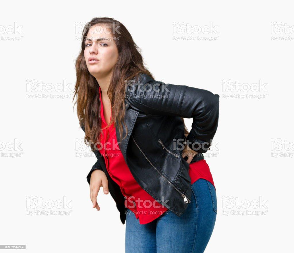 Hermosa Tallas Grandes Mujer Joven Llevando Una Chaqueta De Cuero De Moda En Aislados Fondo De Sufrimiento De Dolor De Espalda Tocando Con La Mano Dolor Muscular Foto De Stock Y Mas