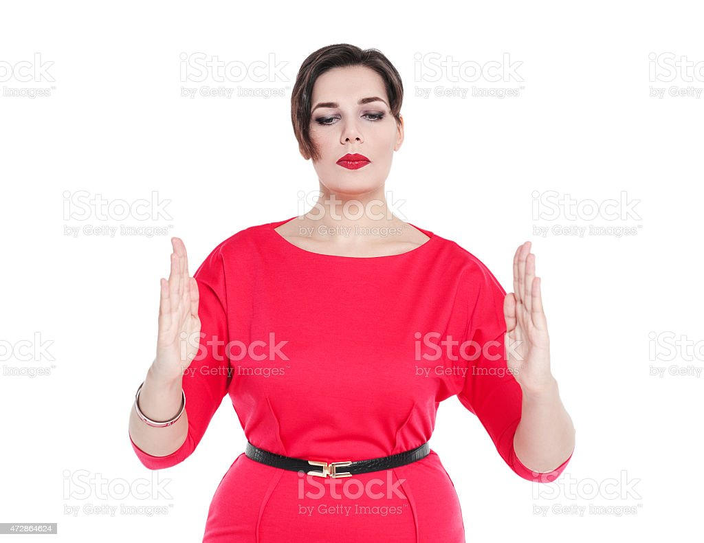 Beautiful plussize woman making size gesture isolated stock photo