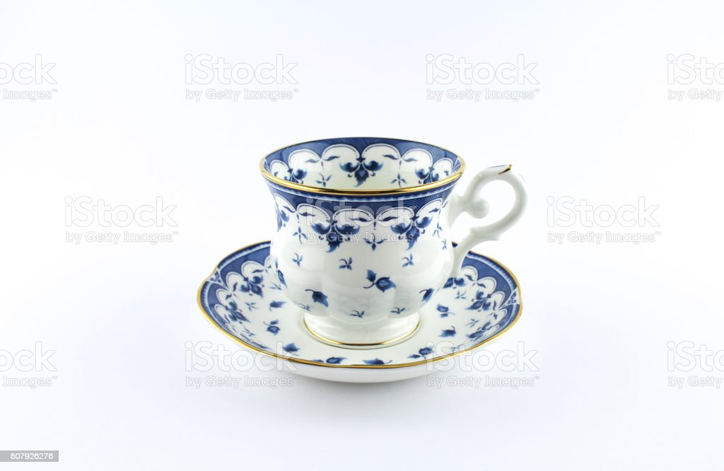Beautiful porcelain cup with blue and gold design stock photo