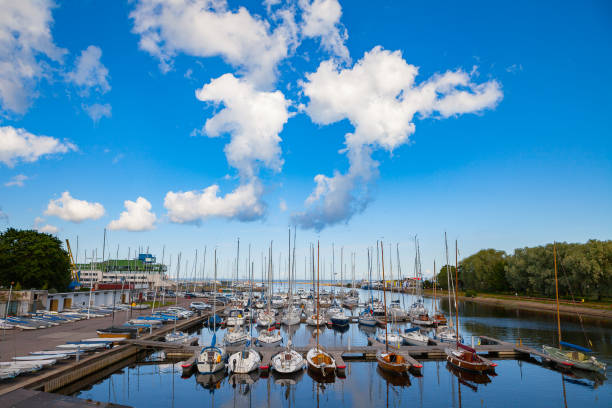 Beautiful port for luxury yachts in the rays of the setting summer sun. Sunset at the port for yachts. Yacht club stock photo