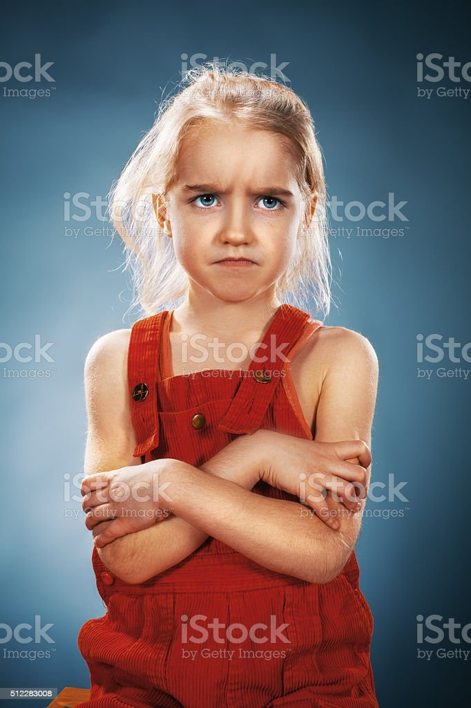 Beautiful portrait of a disaffected little girl stock photo