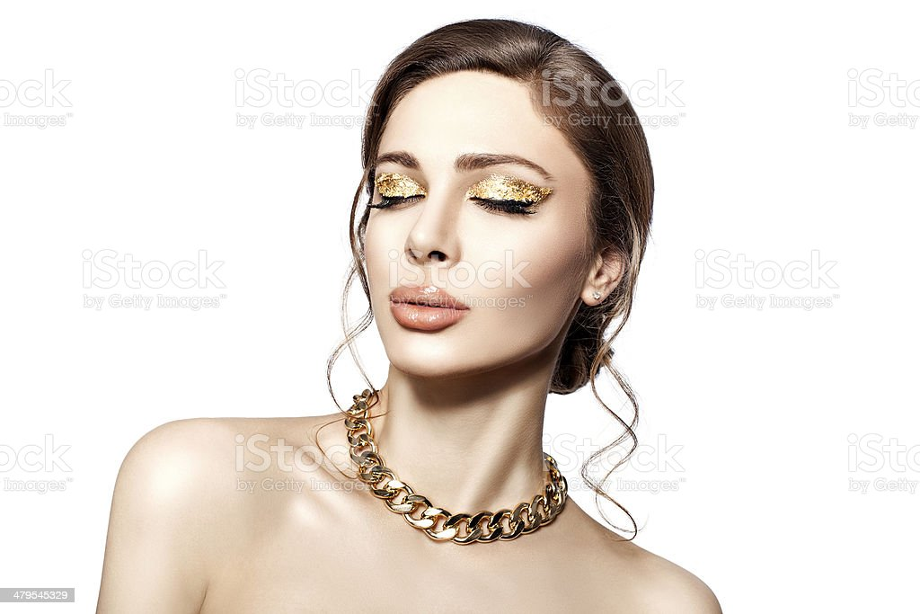 Beautiful portrait of a girl with gold. stock photo