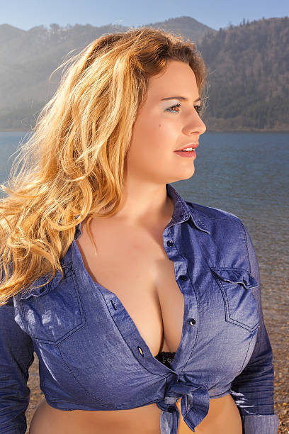 Beautiful portrait of a young woman with large breasts stock photo
