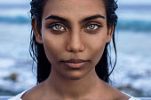 istock Beautiful portrait of indian woman with blue eyes 1213233720