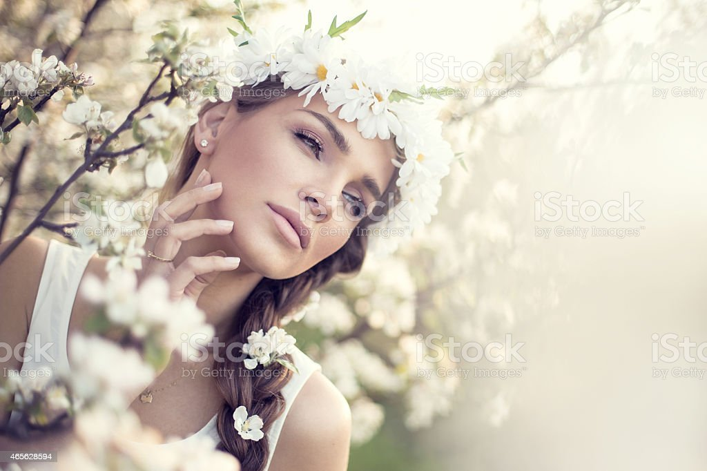 Beautiful portrait of woman in the garden stock photo