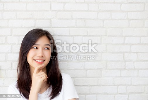 istock Beautiful portrait young asian woman confident thinking with cement and concrete background, girl standing expression serious or doubts with idea, lifestyle concept. 1015149758