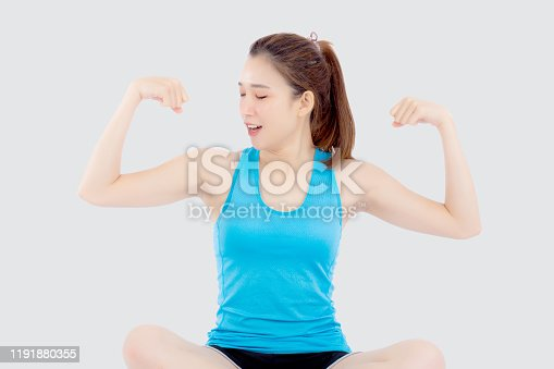 Beautiful portrait young asian woman in sport sitting strong and muscle with health, girl show biceps with exercise and workout for wellness isolated on white background, strength and fit concept.