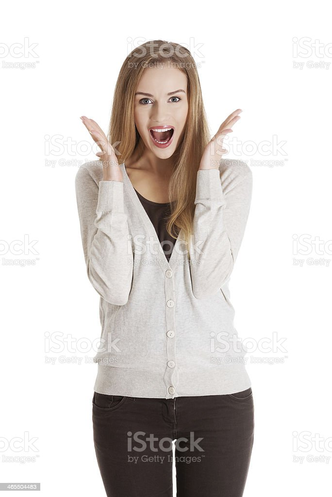 Beautiful positive and casual woman expressing surprise. royalty-free stock photo