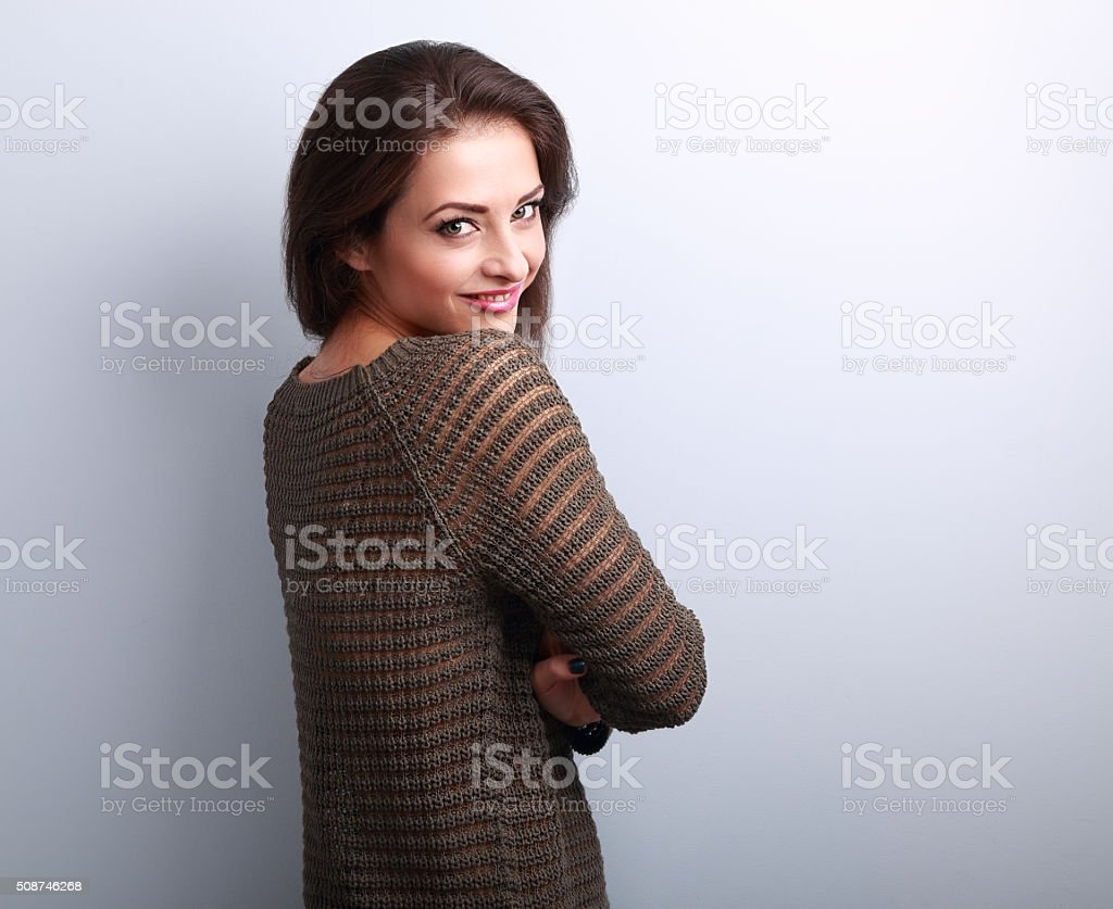 Beautiful positive casual woman in warm sweater looking happy stock photo