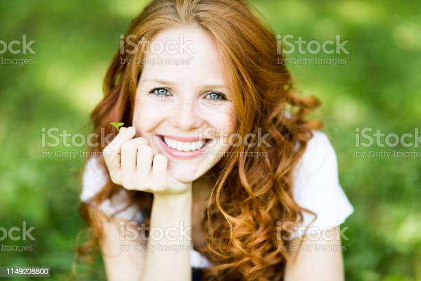 Beautiful positive young redhead woman with blue eyes in nature picture id1149208800?b=1&k=6&m=1149208800&s=612x612&h=bzjz23kpa lk hcucuoxy i8p9rapmu zjiavyiykfg=