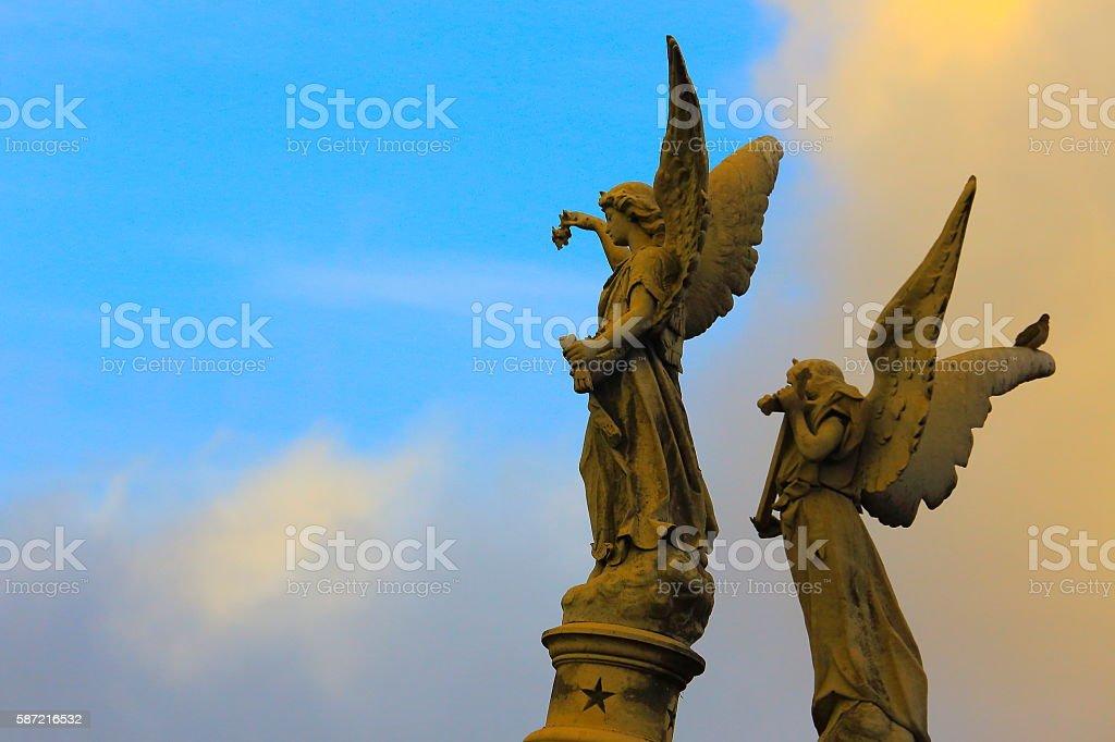 Beautiful powerful Madonna Angels Memorial graves, Recoleta cemetery, dramatic sunset stock photo