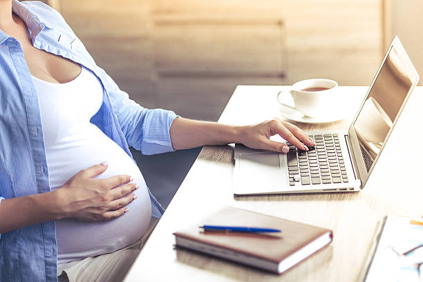 Beautiful pregnant business woman stock photo