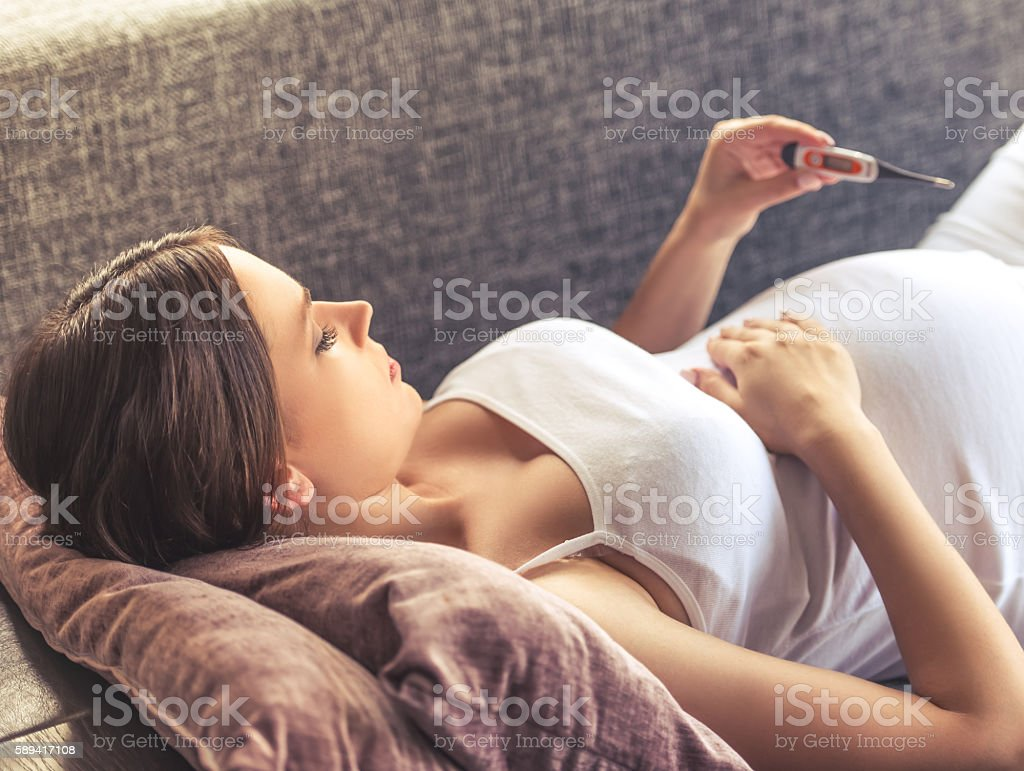 Beautiful pregnant woman at home stock photo